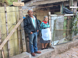 Couple outside of their home near Santa Lucia